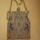 Bolso bordado con microcristales y bastidor con piedras semipreciosas. Bag with embroidery frame and microcrystals with semiprecious stones.